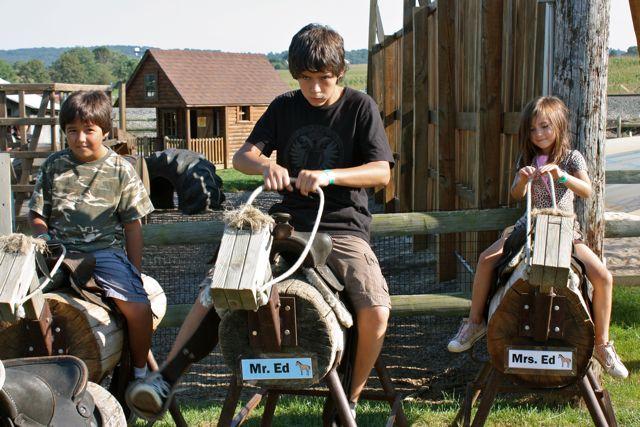 kids ride sawhorses