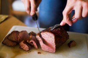cutting up steak